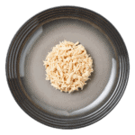 Isolated aerial image of Encore chicken dog food jelly on a plate