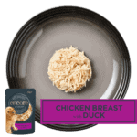 Isolated aerial image of a plate of Encore chicken with duck dog food jelly