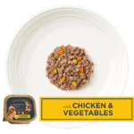 Isolated aerial image of Encore chicken dog food pate with vegetables on a plate