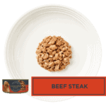 Isolated aerial image of a plate of Encore beef steak dog food in gravy