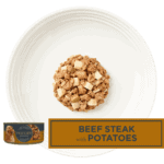Isolated aerial image of a plate of Encore beef steak with potatos dog food in gravy