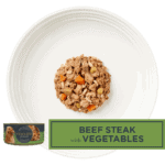 Isolated aerial image of a plate of Encore beef steak with vegetables dog food in gravy