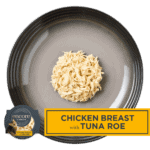 Isolated aerial image of chicken breast with tuna cat food in broth from Encore