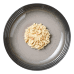 Isolated aerial image of Encore chicken with duck dog food jelly on a plate