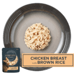 Isolated aerial image of Encore chicken and brown rice cat food on a tray