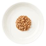 Isolated aerial image of the contents of an Encore beef steak dog food in gravy on a plate