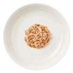 Aerial image of a plate of Encore tuna with shrimp cat food in broth on a plate