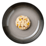 Isolated aerial image of Encore chicken with tuna dog food jelly with vegetables on a plate