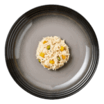 Isolated aerial image of Encore chicken with garden vegetables dog food jelly on a plate