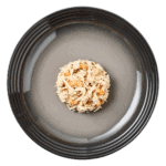 Isolated aerial image of a plate of Encore chicken and prawn cat food