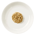 Isolated image of a plate of tuna cat food with anchovy and seaweed