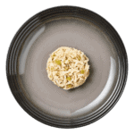 Isolated aerial image of a plate of Encore chicken cat food with asparagus