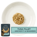 Isolated aerial image of a plate of tuna cat food with anchovy and seaweed