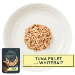 Isolated close up of a plate of Encore cat food tuna and whitebait in broth